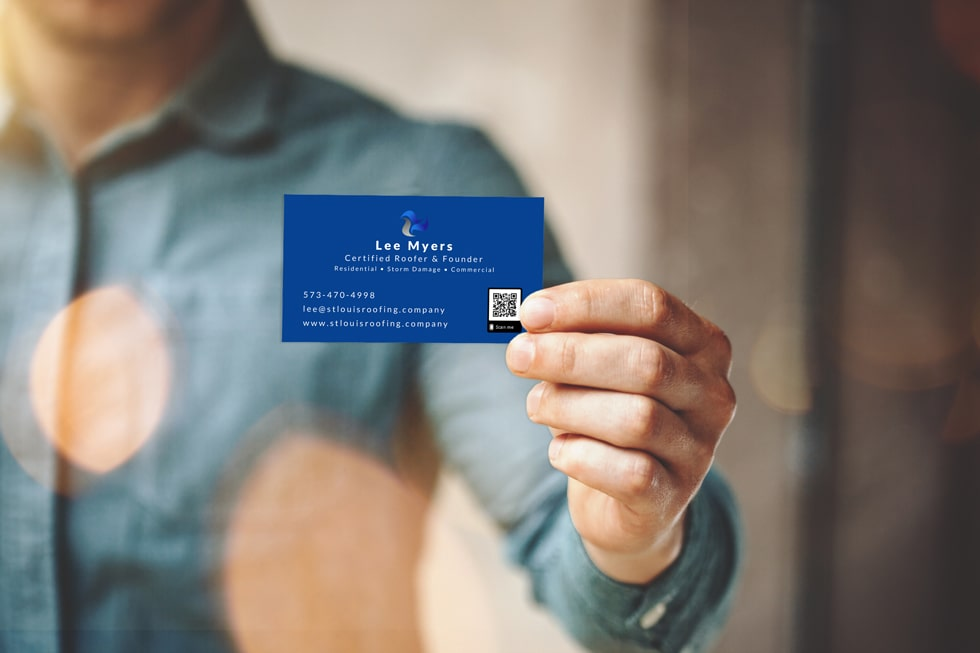 Photo of a man holding a SCRS Roofing business card